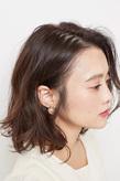 毛先のハネ感が躍動的なミックスカールボブ