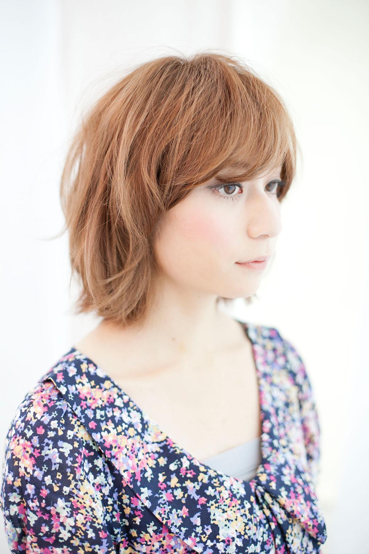空気感たっぷりのヘアスタイルでかわいらしい女の子っぽいスタイルに