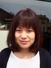 オレンジブラウンくせ毛風ミディアムロング|hair Shantii 河内国分店のヘアスタイル